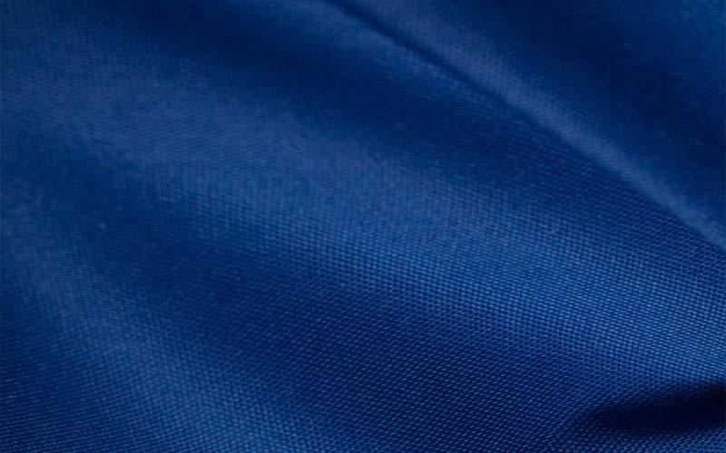 Фото: Ткань из полиэфирных волокон синего цвета